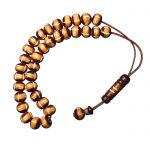 Worry bead, made of carved camel bone stones, with a fine wooden finish