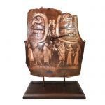 Copper Armor, Ancient Olympia, Clock with depictions of Zeus and Apollo with his lyre, placed on wooden base.