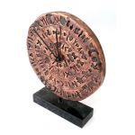 Phaistos Disc Clock. Handmade copper with natural oxidation and Greek marble base.