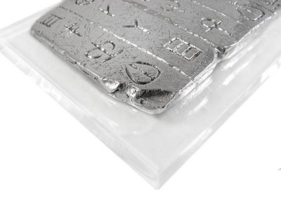 Linear A, Paper-weight, Silver plaque, mounted on an acrylic base.