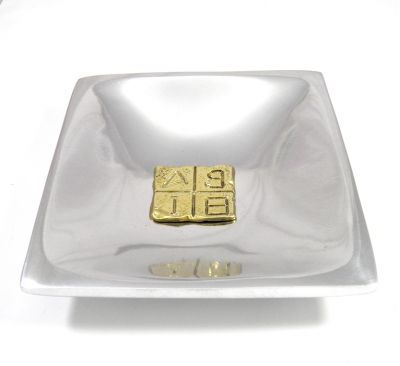 Greek Alphabetic Script brass plaque placed in the center of a recycled aluminum ashtray