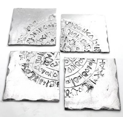 Paistos Disc, Aluminum Coaster. The photo shows the set of four which altogether form the Disc.