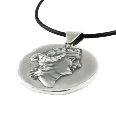 Thassion, Pendant in silver 999° with black satin cord, depicting the head of Dionysus.