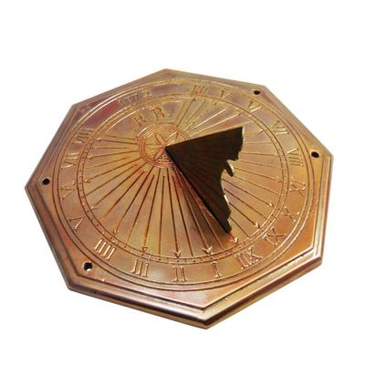 Solar Clock, with engraved details and roman numbers, indicating the hours, made of copper.