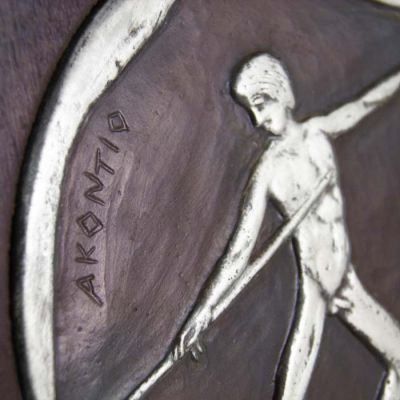 Javelin Throw, Olympic Games, Detail of the copper plaque with patina, plated in silver solution 999° and mounted on wooden frame.