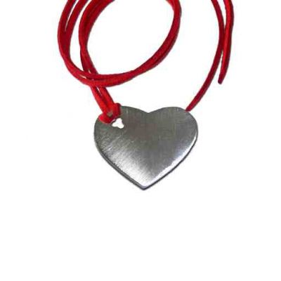 Solid Heart, Pendant, Silver 925°, hanging on a red suede cord.