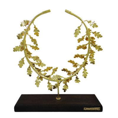 Oak Wreath, Gold-plated 24K handmade brass, placed on a wooden or a black marble base.