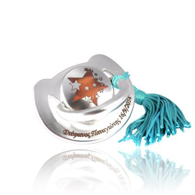 Baby pacifier coated with copper, silver-plated in silver solution 999° and egraved by laser