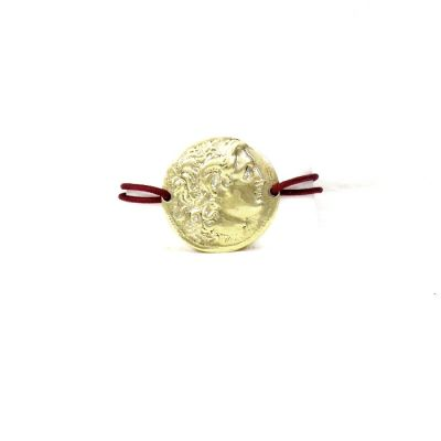 Alexander the Great Brass Bracelet. The cord is adjustable to fit all wrists with its special tying.