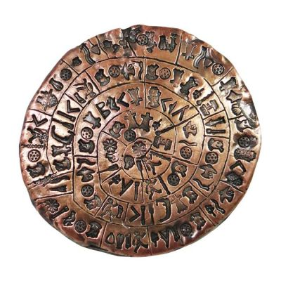 One side of the Disc of Phaistos found in Crete. Handmade copper with natural oxidation.